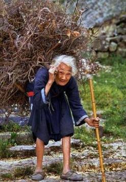 old-woman-heavy-load
